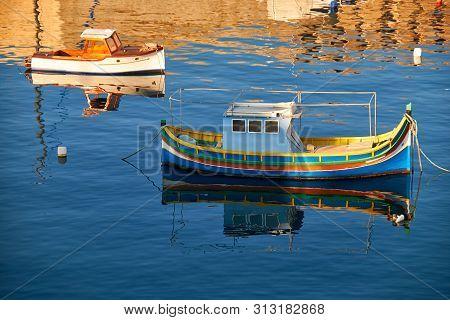 National Maltese Bout Luzzu In Malta Bay Between Birgu And Kalkara At Morning Time