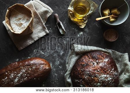 Bread On A Black Background. Homemade Pastries With Ingredients. A