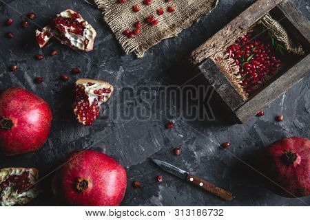 Beautiful Composition Of Pomegranates On A Dark Background With A Towel, Healthy Food, Fruit A