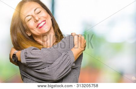 Beautiful middle age business woman Hugging oneself happy and positive, smiling confident. Self love and self care