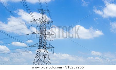 Electric Pole And Electricity Energy Concept - High Voltage Electric Pole With Blue Sky And Copy Spa