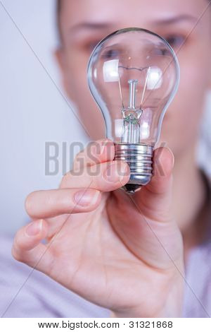 Woman Holding Electrical Lamp
