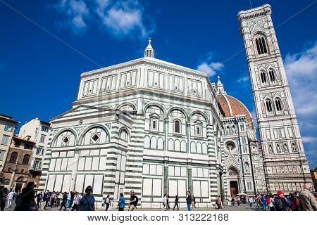 Florence, Italy - April, 2018: Tourists At The Baptistery Of St. John, Giotto Campanile And Florence
