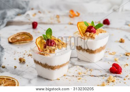 Tasty Mousse Dessert With Jelly And Berries In A Glass On Light Background Close Up. Delicious Desse