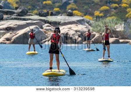 Stand Up Paddleboarding On Lake. Watersport On Lake. Tourist Outdoor Activity At Lagoa Comprida, Ser