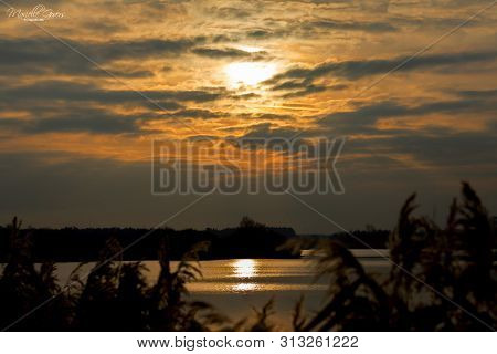 Dramatic sunset cloudy sky with picturesque clouds lit by warm sunset sunlight, natural sunset sky l