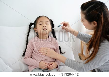 Asian kid girl have a discomfort as the flu must have adequate rest. And mother using a body thermometer Is primary treatment While resting will give the body strong back. Concept of health insurance poster