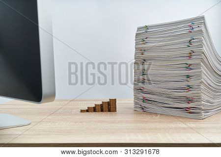 Step Pile Of Gold Coins And Pencil On Notebook With Stack Of Overload Paperwork Report Of Sale On Wo