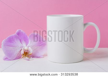 White Coffee Mug Mockup On The Pink Background With Purple Orchid. Empty Mug Mock Up For Design Prom