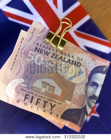 Bundle Of New Zealand Dollars With The Nz Flag.
