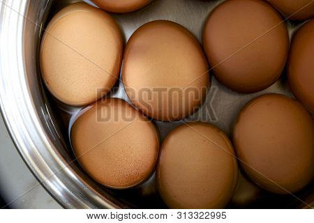 Brown Hard Boiled Hen Eggs In A Saucepan.