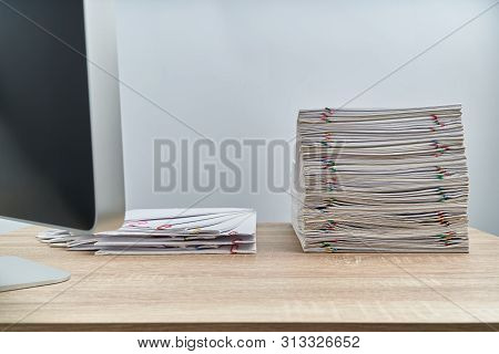 Arrange Pile Overload Paperwork Report And Computer On Wooden Table