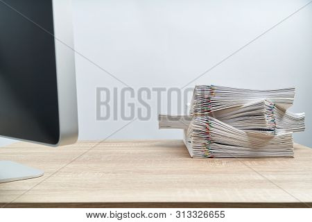 Arrange Of Overload Document Report And Computer On Wooden Table