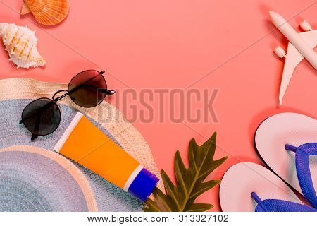 Top View Of Traveler Accessories, Tropical Palm Leaf And Airplane On Pink Background With Empty Spac