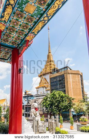 View Of The Spire Of Wat Traimit From Underneath The China Gate, Bangkok, Thailand