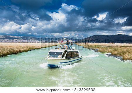 Titicaca, Peru- Jan 5, 2019: Travel by boat at Titicaca lake near Puno, Peru, South America.