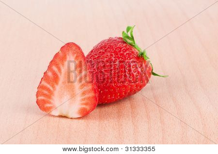 Red strawberry on the wooden cutting board