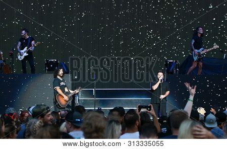 WANTAGH, NY - JUL 20: Dan Smyers (L) and Shay Mooney of Dan + Shay perfor  during the
