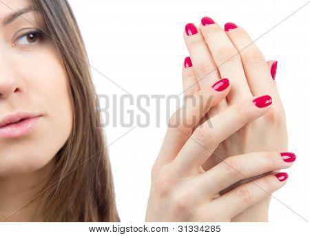Beautiful Female Hands Red Manicure Shellac  Near Face