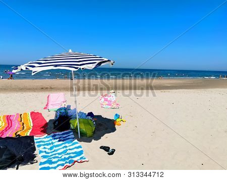 beach umbrella/parasol on the beach on a sunny day