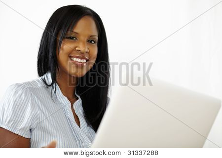 Cute Young Woman Using A Laptop