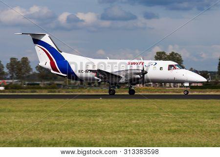 Amsterdam / Netherlands - August 14, 2014: Swiftair Embraer 120 Ec-imx Cargo Plane Landing At Amster