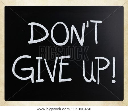 """""""don't Give Up"""" Handwritten With White Chalk On A Blackboard"""