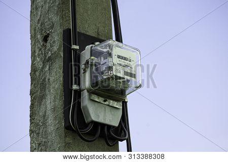 Electricity Meter Reading Against Blue Sky Background, Meter Measuring Instrument, Watt-hour Meter T