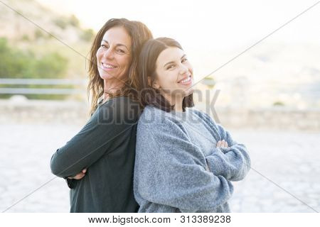 Beautiful family of mother and daugther smiling cheerful, two happy women together as woman power