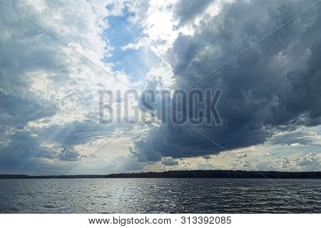 Dramatic Sky Over A Lake In Summer