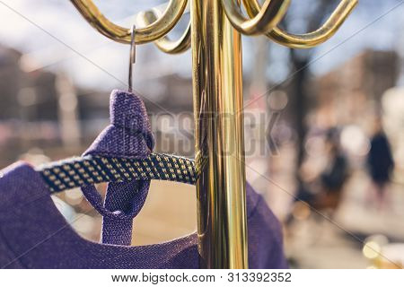 Flea Market, Purple Dress Hanging On A Golden Clothes Rack