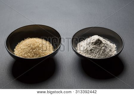 Brown Sugar And Wheat In Black Asian Bowls