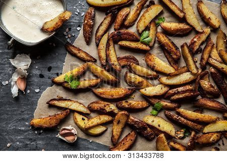 Delicious Potatoes With Rosemary On Parchment, Closeup A