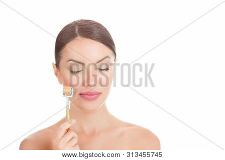 Beauty Girl Using Derma Roller. Close Up Portrait Smiling Cute Beautiful Woman, Showing Mezo-roller,