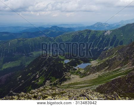 View From Banikov Peak On Western Tatra Mountains Or Rohace Panorama. Sharp Green Mountains Ostry Ro