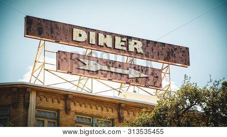 Street Sign To Diner