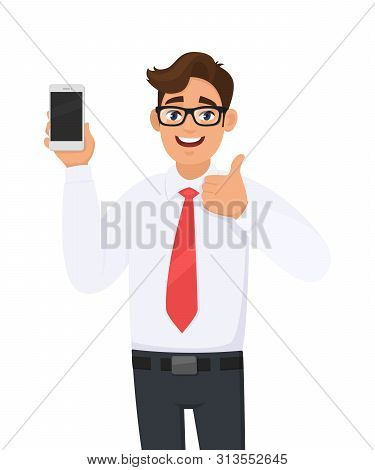 Positive Business Man Showing New Brand, Latest Smartphone. Man Holding Cell, Mobile Phone In Hand A