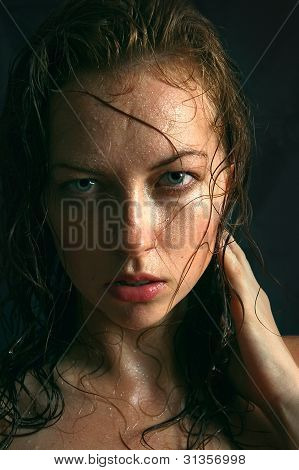 Portrait of a pretty woman with wet hair