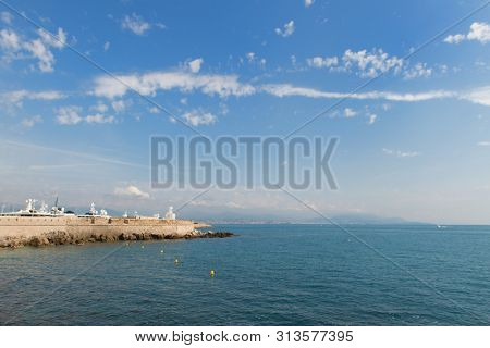 Boats in the harbor of Antibes with wall of fort carre