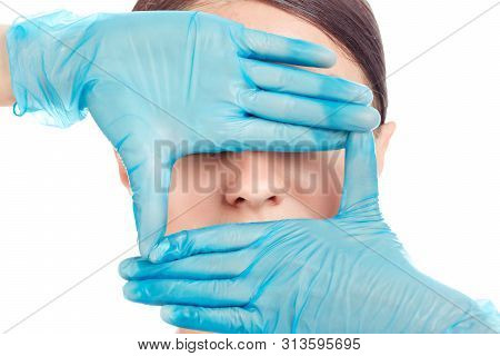 Doctor Hands In Gloves Around Nose Of A Girl. Woman Is Preparing To Have Nose Surgery Done, Isolated