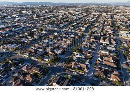 Afternoon aerial view of middle class homes and streets in Los Angeles County, California.