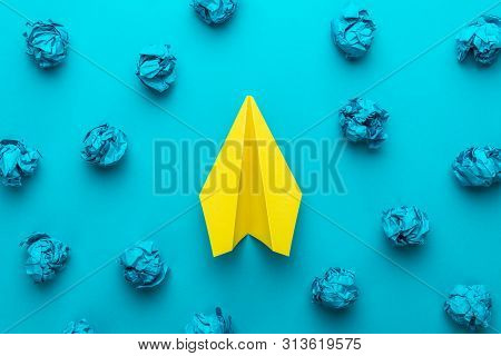 Great Business Idea Concept With Blue Crumpled Office Paper And Yellow Paper Plane In The Centre. To