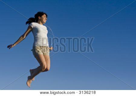 Teen Girl Soaring In The Air