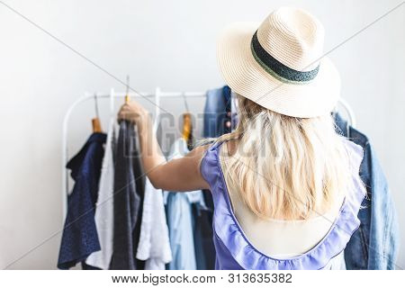 Blondy Girl Near A Wardrobe With Clothes Can Not Choose What To Wear