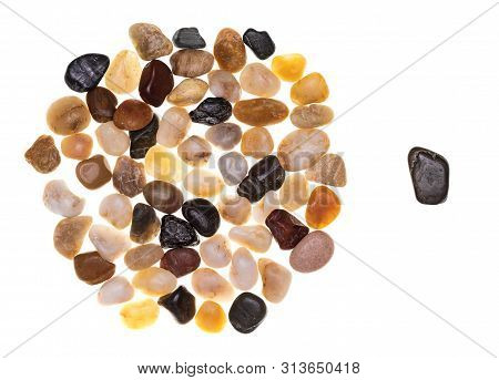 Concept Of Exclusion And Racism Made With A Group Of Multi-colored Stones (multicolored). Multidisci