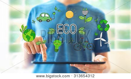 Eco Theme With Young Man Using A Tablet Computer