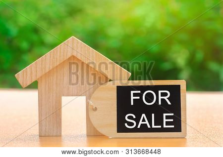 A Miniature Wooden House And Inscription For Sale. The Concept Of Selling A Home Or Apartment. Prope