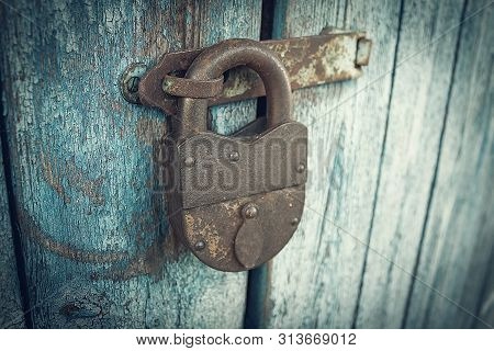 Security-safe Lock. An Old Native Castle. Lock Security Guard. Lock On The Door
