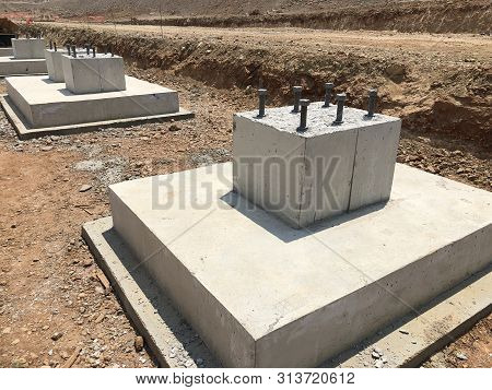 Row Of Reinforced Concrete Foundations With Metal Anchor Bolts Designed For The Installation Of Meta