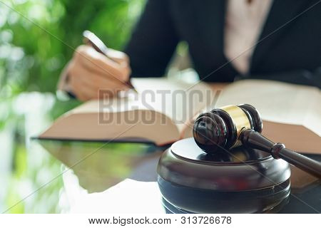 Judge Gavel And Lawyer Working With A Book. Selective Focus